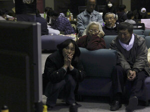 Evacuees watch television news on a troubled nuclear power plant at a makeshift shelter in  Fukushima, northern Japan,  Tuesday. (AP Photo/)