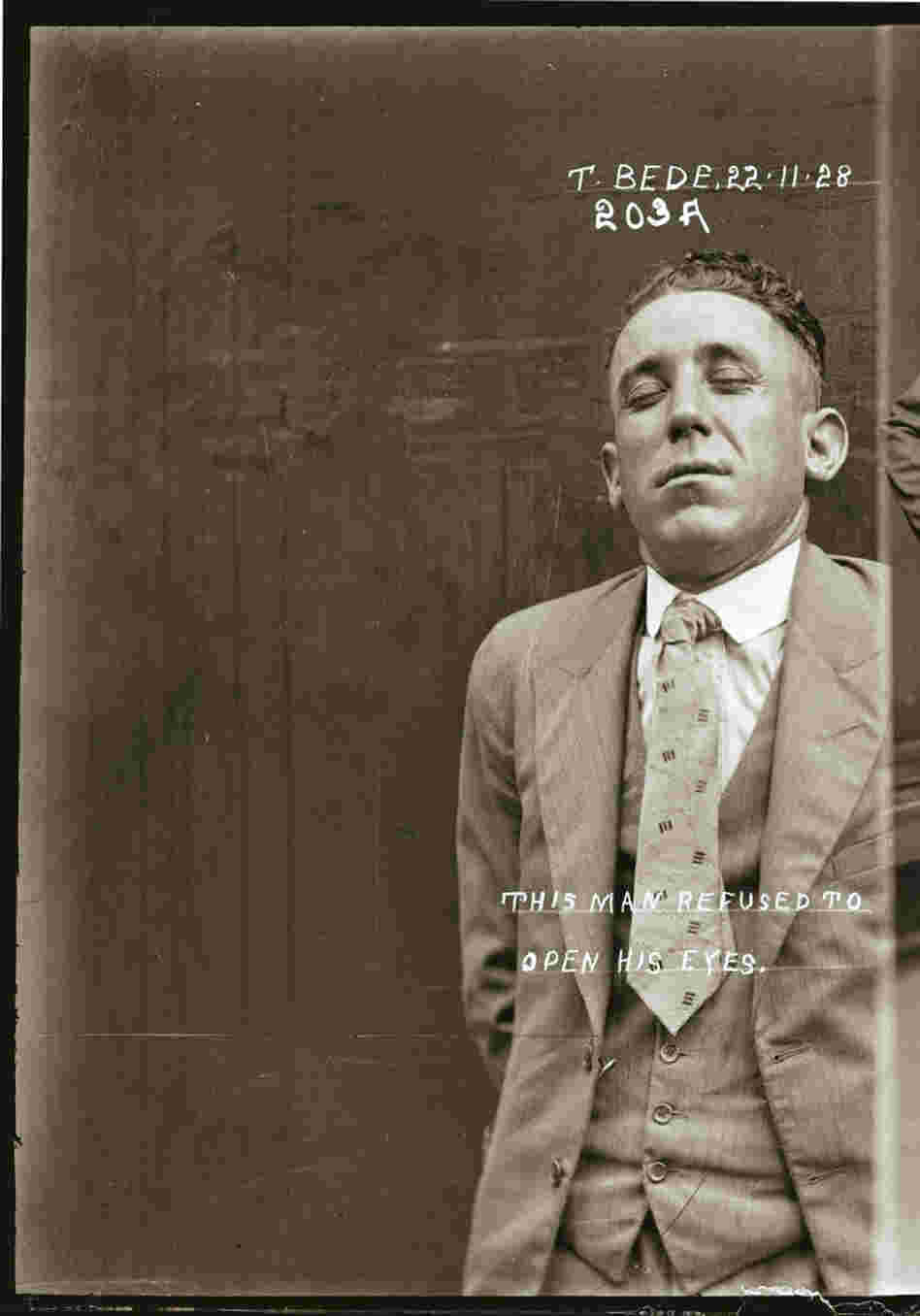 "Mug shot of Thomas Bede, Nov. 22, 1928, Central Police Station, Sydney. (On the image is says, ""This man refused to open his eyes."")"