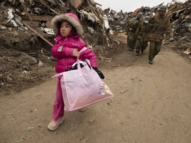 Riku Zentaka, Japan: Neena Sasaki, 5, carries some of the family belongings from her home that was destroyed after the devastating earthquake and tsunami.
