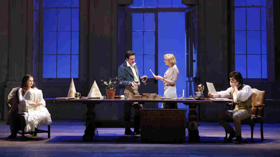 Two Houses, Both Alike: In a scene that fuses two moments across two centuries, 19th-century math prodigy Thomasina (Bel Powley, left) and her tutor Septimus (Tom Riley) flank the central table of Arcadia's set, joined in the center by the present-day Valentine (Raul Esparza) and Hannah (Lia Williams).