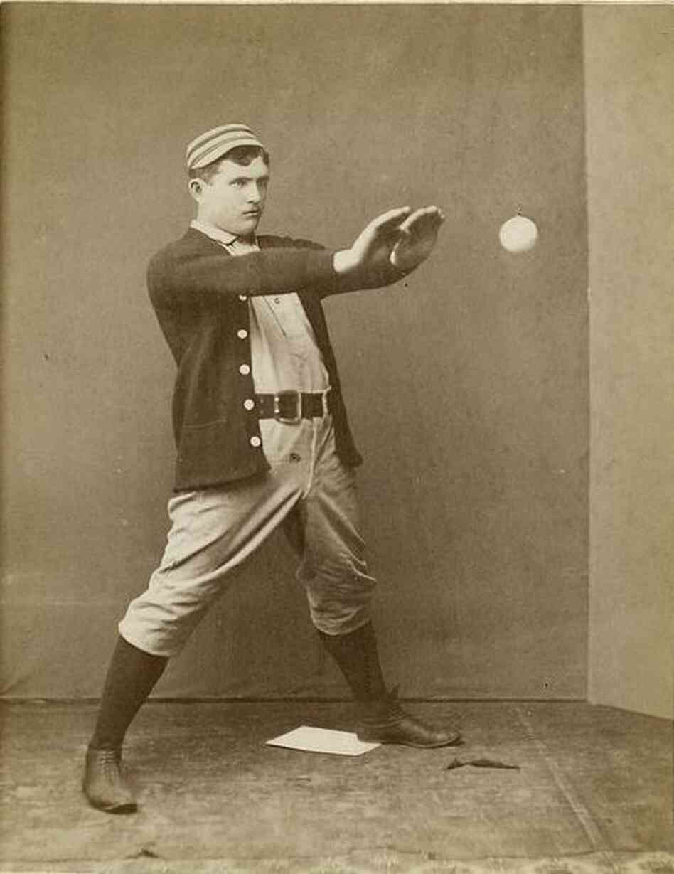 Jack Clements, a player on the Philadelphia Quakers, poses at a photography studio in Boston in the days before players carried mitts onto the baseball diamond.