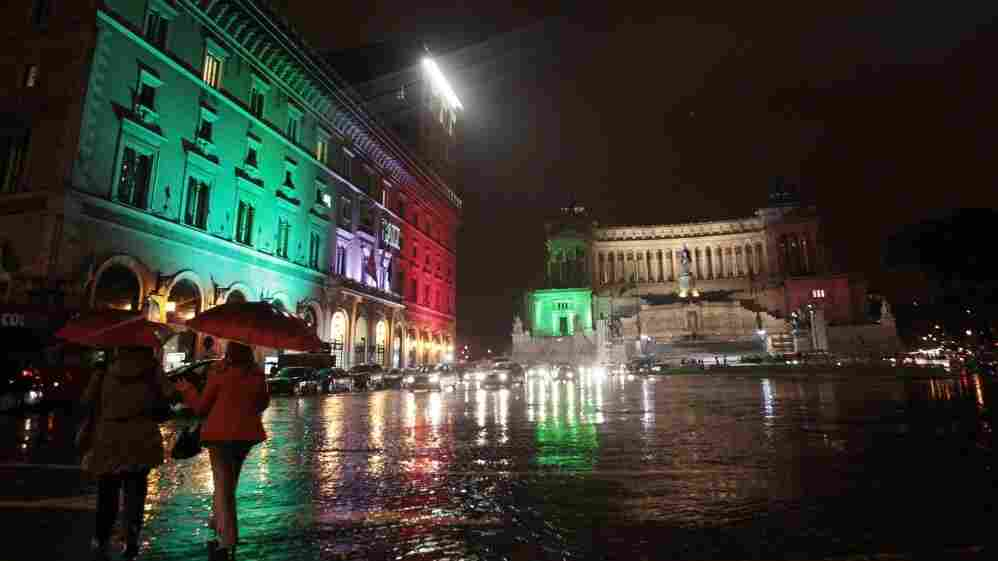 In Rome, the Vittoriano monument — also known as Altare della Patria, or Altar of the Fatherland, background right — and the surrounding buildings are lit with the colors of the national flag this week to mark the 150th anniversary of Italy's unification. On March 17, 1861, Victor Emmanuel II became the first king of a united Italy.