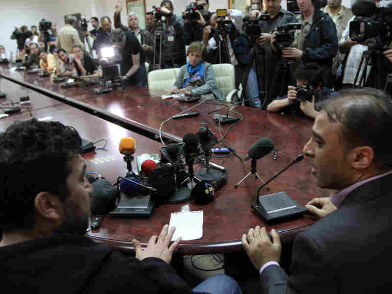 Spokesman Ibrahim Moussa (right) translates for Salah Abu Oba, a man the Libyan government claims is affiliated with al-Qaida.
