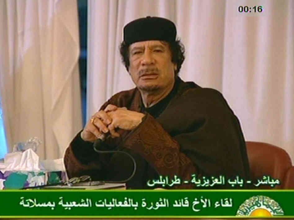 A jubilant Libyan leader Moammar Gadhafi appears Tuesday on state television. Gadhafi's forces have been pressing their advantage against rebels, with relentless shelling in the east and west.