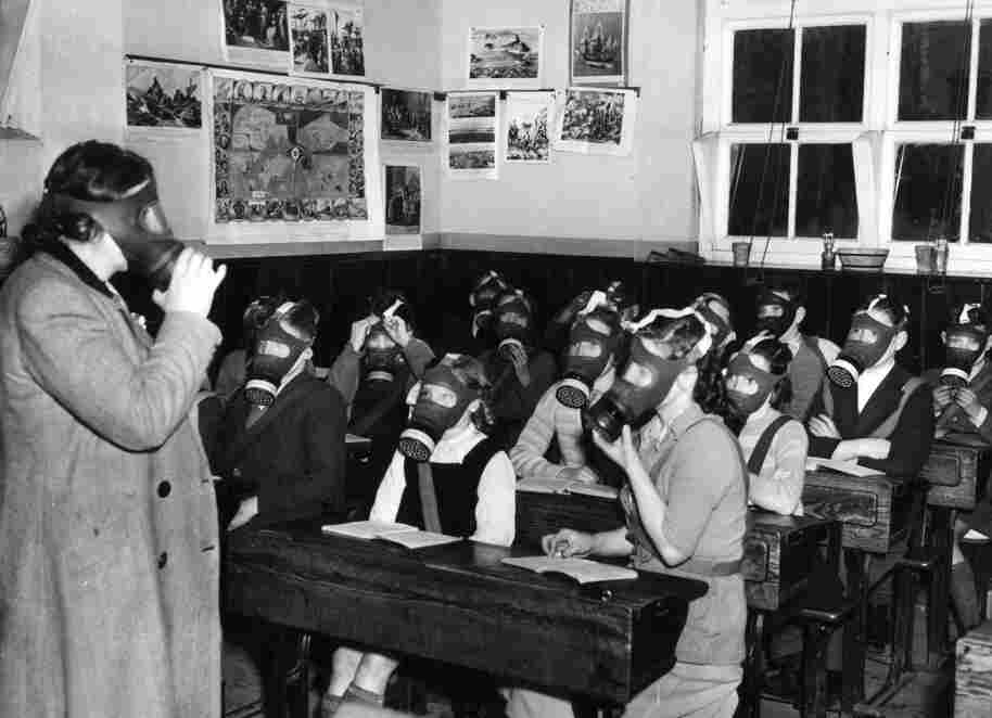 On Feb. 14, 1950, the headmistress of the village school in Shropshire, England, supervises the children in their monthly gas mask drill.