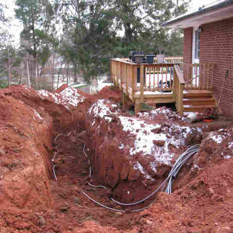 Homeowners Suzi and James Bryant opted to install a geothermal system. To save some money, they rented a backhoe and dug a deep ditch in their side yard for the project.