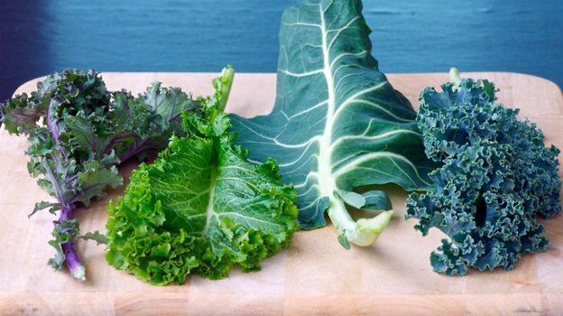 Although they're known for being a stellar side dish, greens can be added to soups and stews, chopped into salads and omelets and added to rice and pasta dishes. From left: Red kale, mustard greens, collards and kale. (Susan Russo for NPR)