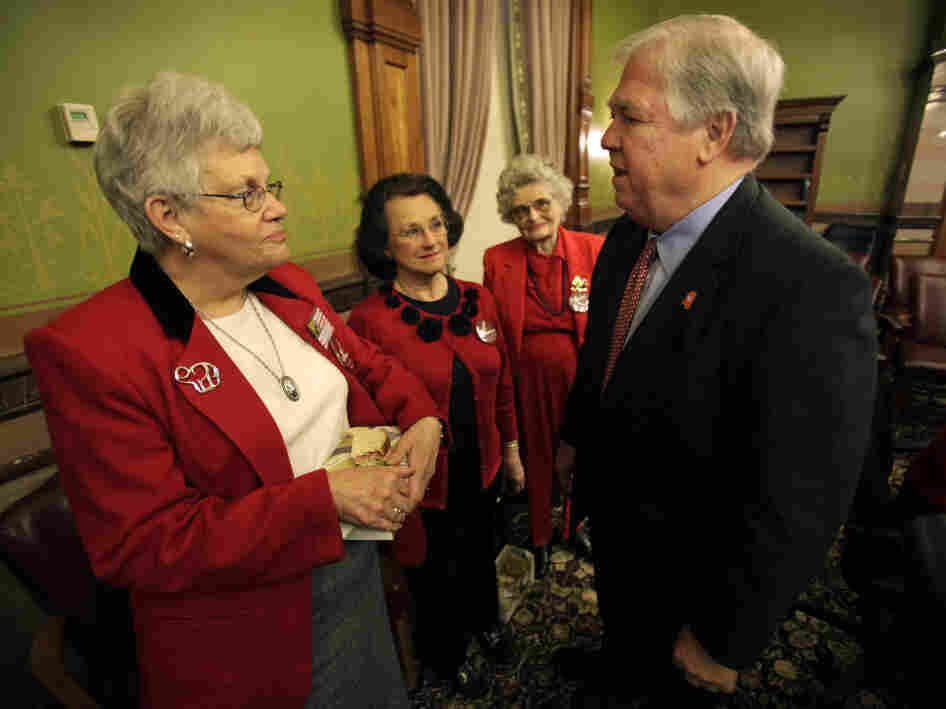 Mississippi Gov. Haley Barbour chats with some Iowa Republicans, March 15.