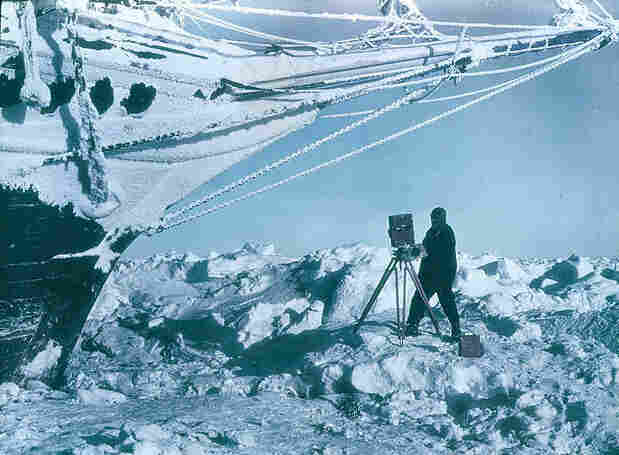 Frank Hurley photographs the frozen bow of the Endurance.