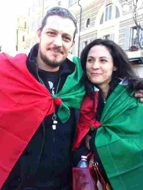 """Screenwriter Marcello Izzo and his girlfriend wrapped in Italian flags. """"I will take to the streets if necessary to defend our constitution and Italian unity,"""" Izzo says."""