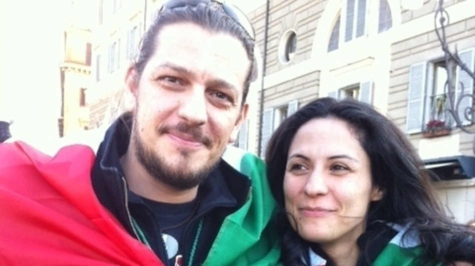 "Screenwriter Marcello Izzo and his girlfriend wrapped in Italian flags. ""I will take to the streets if necessary to defend our constitution and Italian unity,"" Izzo says."