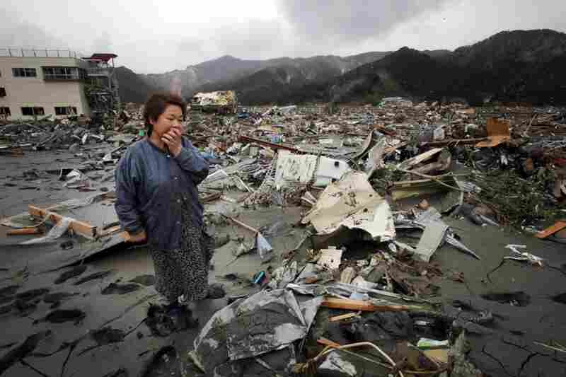 Reiko Miura, 68, cries as she looks for her nephew at in Otsuchi, Iwate prefecture, northern Japan.