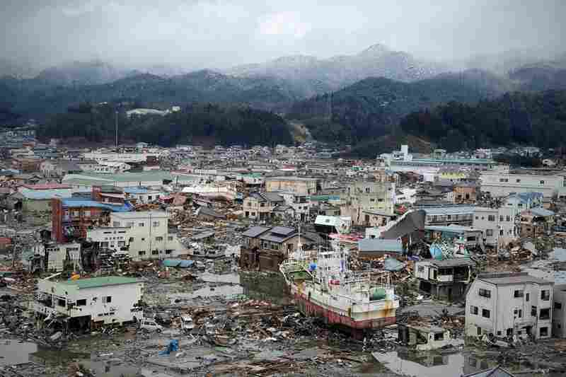 Houses and boats sit side-by-side in the devastated city of Kesennuma.