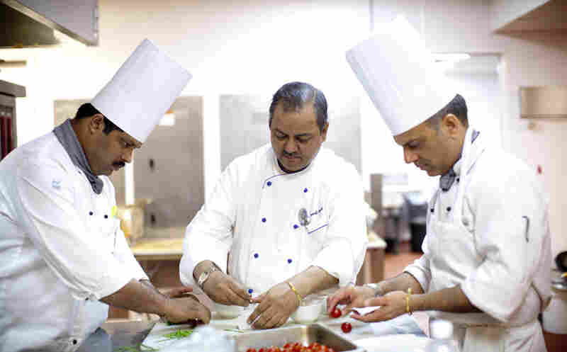 Oberoi (center) has worked for nearly 30 years at the Taj Mahal Palace and Towers, a luxury hotel in Mumbai. He was working at the hotel on Nov. 26, 2008 — the day terrorists attacked The Taj and several other sites in Mumbai. Gunmen roamed the halls of the hotel for hours, shooting anyone in sight.