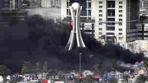 Black smoke billowed from burning tents in Pearl Square in Manama, Bahrain, earlier today (March 16, 2011).