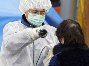 Medical staff checks radiation levels of a resident in Koriyama city in Fukushima prefecture, Japan. Radioactivity ratings remain high in the prefecture, home to the Fukushima Daiichi nuclear  power plant.