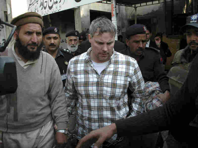 In this Jan. 28 photo, Pakistani security officials escort Raymond Davis (center) to a local court in Lahore. Davis was released Wednesday and immediately left the country for Kabul.
