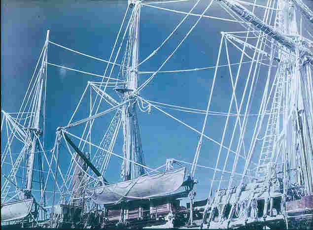 The rigging of the Endurance is highlighted by rime — brilliant white ice left by freezing fog.