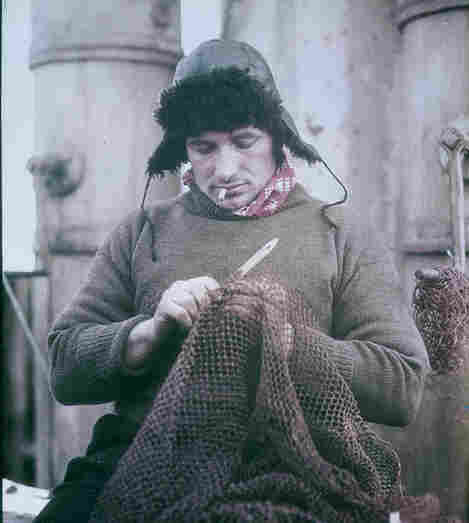 John Vincent mends a net.