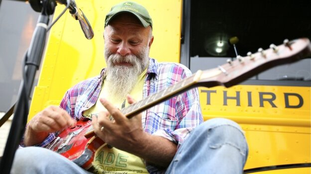 With only three strings, Seasick Steve plays some blues at the Third Man Records Truck.