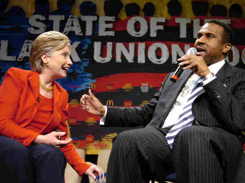 """Then-Sen. Hillary Clinton speaking with television talk show host Tavis Smiley at the """"State Of The Black Union"""" in 2008. Last March, Smiley organized another event in the hopes of calling President Obama's attention to the well-being of African Americans, a move some say was not effective enough."""