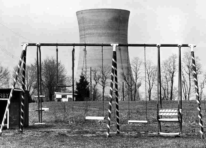 A cooling tower of the Three Mile Island nuclear power plant near Harrisburg, Pa., looms behind an abandoned playground on March 30, 1979, two days after the initial reactor emergency.