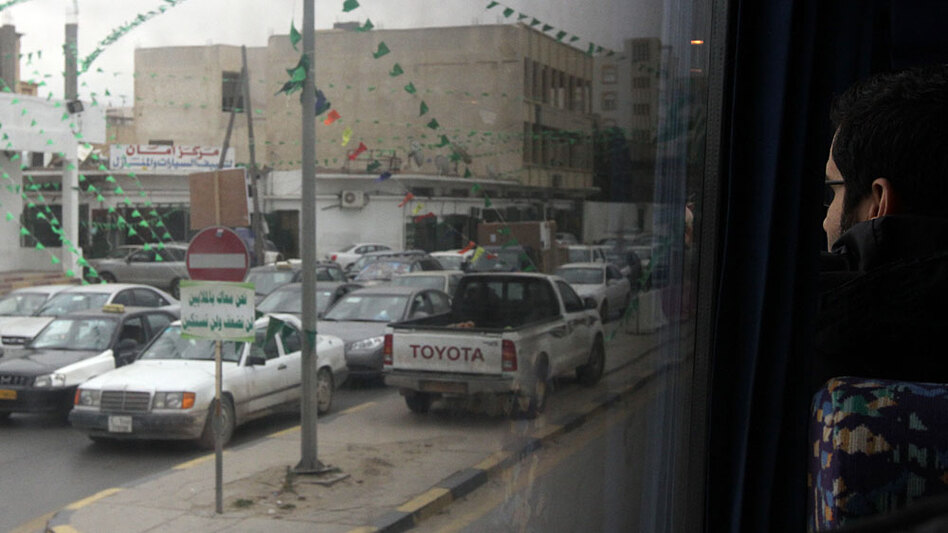 Access is severely restricted for journalists in Tripoli. Often, their view of life in the capital city is through the window of a massive bus on government-sponsored trips.