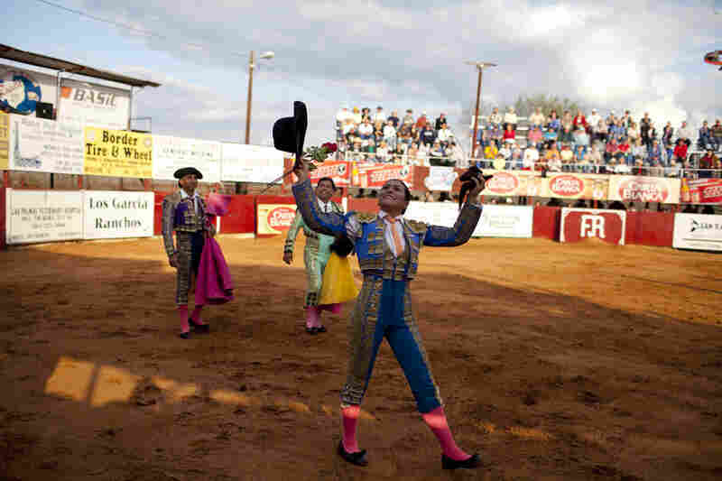 Lopez salutes the crowd after a bullfight.  Bullfighting is all Lopez has ever known and all she's ever wanted to do.