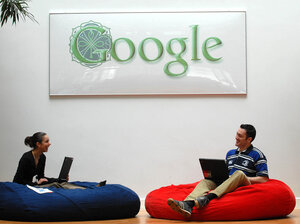Employees at Google's Dublin office relax underneath the Irish-themed Google logo. Shifting most of its overseas profits through the Dublin office has saved Google billions in taxes.