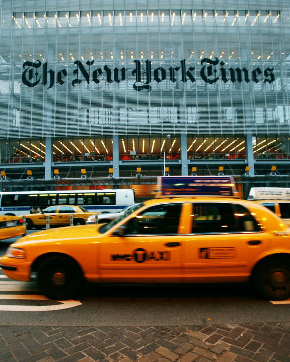 <em>The New York Times</em> announced Thursday that the paper would embrace a metered approach to an online pay wall. As of March 28, online users will be able to view up to 20 pages per month. Beyond 20 page views, readers will have to pay $15 monthly for Web access. (Mark Lennihan/AP)