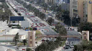 Bahraini troops block streets lea