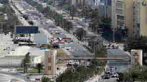 Bahraini troops block streets leading to Pearl Square in the capital Manama on March 16, 2011.