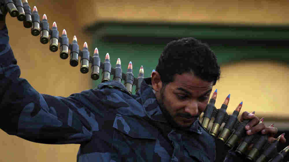 A rebel carried an ammunition belt in the streets of the eastern Libyan coastal town of Tobruk near the border with Egypt on Wednesday (March 16, 2011).