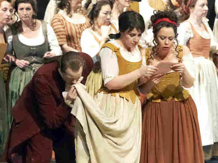 Cherubino (Anna Bonitatibus, center), dressed as Susanna, prepares to deceive the Count.