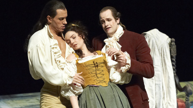 The scheming Count Almaviva (Erwin Schrott, left) and Basilio the music master (Benjamin Bruns) prop up a swooning Susanna (Slyvia Schwartz), the object of the Count's nefarious affections. (Wiener Staatsoper)