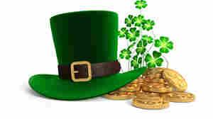A green felt hat, coins, and a clover.