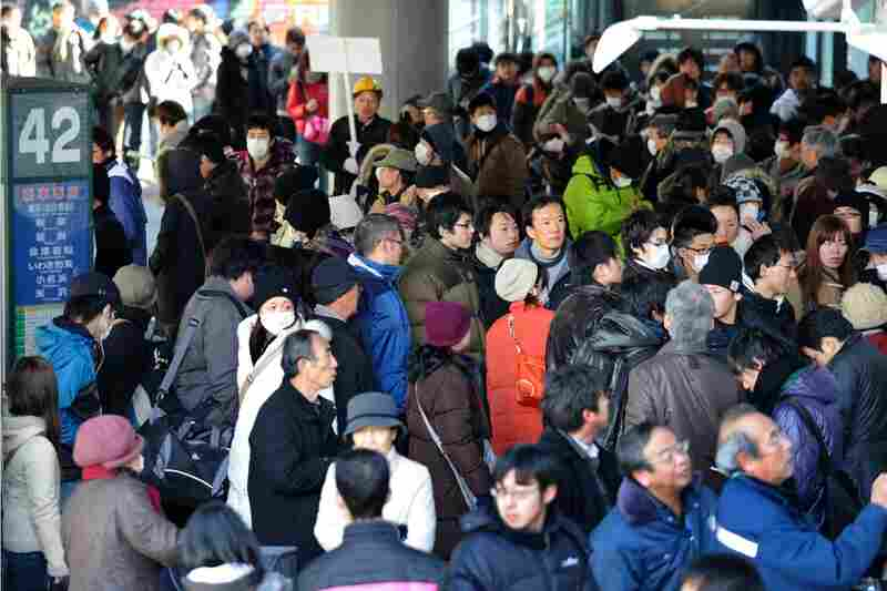 People crowd at a bus terminal in front of Sendai Railway Station in Miyagi prefecture. Railway services have been canceled since the earthquakes around the area.