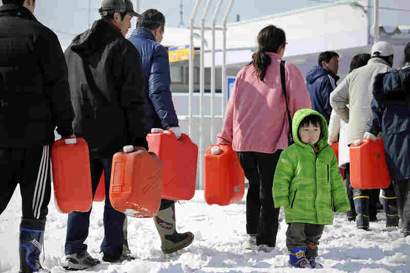 People wait in line for gasoline at a filling station in Ichinoseki, Iwate.  Heavy blizzards swept across Japan's northeast overnight.