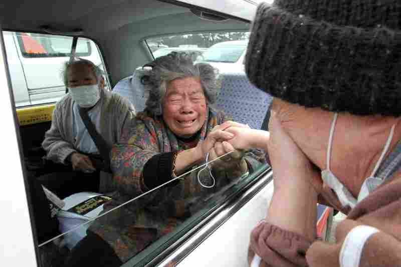 Fuyo Murakami (center) and her husband Yoshiro (left) say goodby to a relative as they leave for Hokkaido in northern Japan.