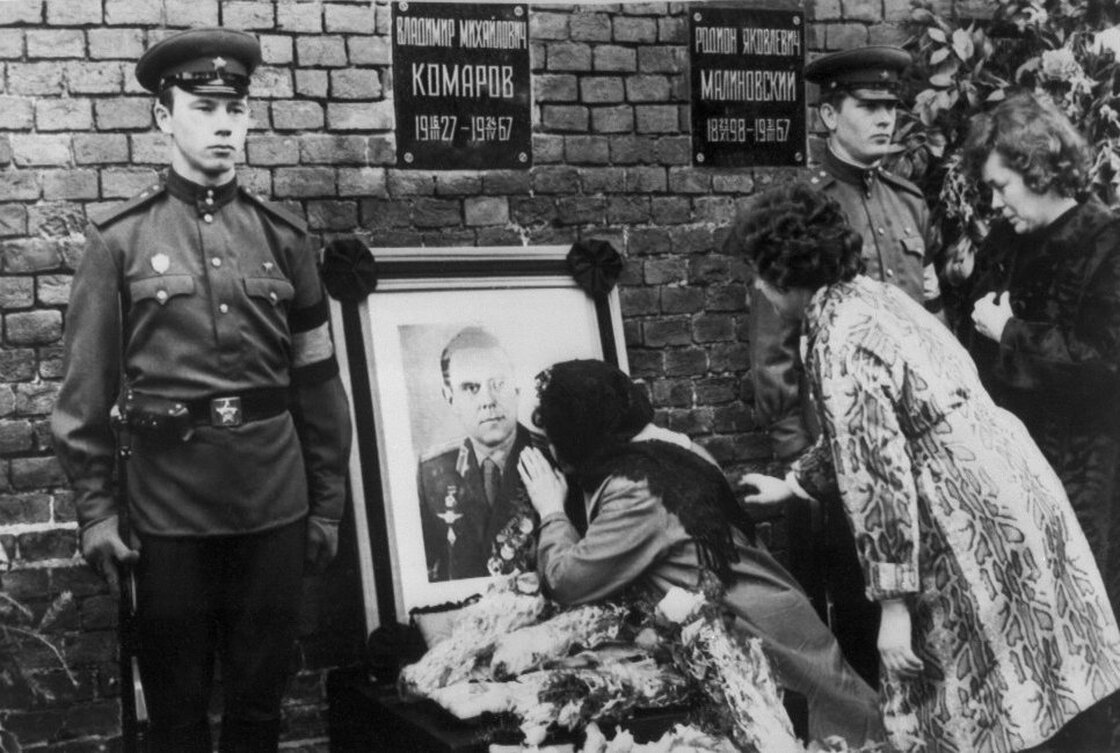 Valentina Komarov, the widow of Soviet cosmonaut Vladimir Komarov, kisses a photograph of her dead husband during his official funeral, held in Moscow's Red Square on April 26, 1967.