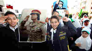 "Children holding portraits of Moammar Gadhafi demonstrate outside the U.N. mission headquarters in Tripoli on Thursday. Libyan state-run television said that forces loyal to Gadhafi had wrested control of Misrata, one of the last rebel-held bastion, and were ""purging"" it of insurgents."