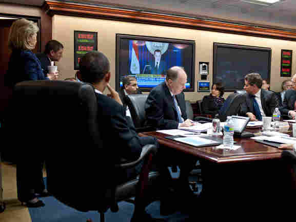 President Obama in the White House Situation Room watches then-Egyptian President Hosni Mubarak on TV.