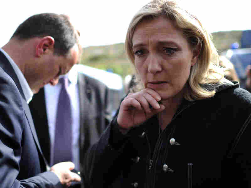 Marine Le Pen, far-right leader of France's National Front Party, waits with the party's Louis Aliot outside an immigrant detention center during her visit to the Italian island of Lampedusa on March 14.