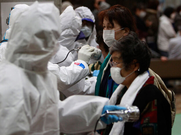 Evacuees are screened for radiation exposure at a testing center in Koriyama city, Fukushima prefecture, northern Japan.