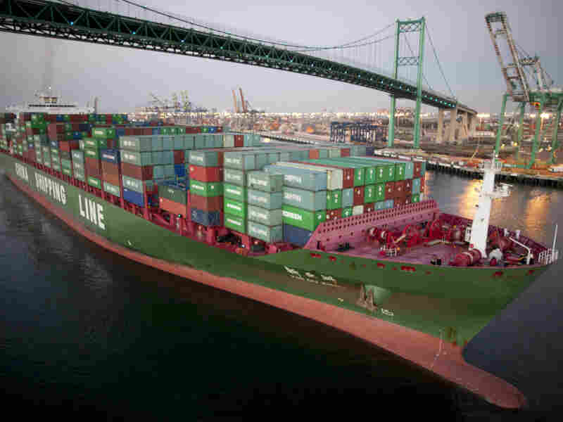 A cargo container ship passes under the Vincent Thomas Bridge at the Port of Los Angeles. Officials say the facility regularly monitors for any potential source of radiation.