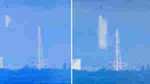 Screen grabs from Japan's NHK broadcaster shows a Japanese military helicopter dumping water onto reactor Number Three at the stricken Fukushima nuclear power plant on March 17, 2011.