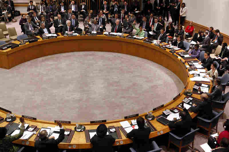 "Member states vote on the resolution to impose a no-fly zone over Libya during a meeting of the United Nations Security Council on Thursday. In addition to the no-fly zone, the resolution authorizes ""all necessary measures"" to protect civilians from attacks by Gadhafi's forces."