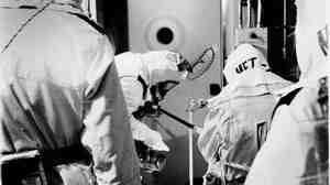 Three Mile Island engineers William Behrle (from left0, Michael Benson, Sam Griffith and Martin Cooper enter the containment building from the personal airlock in Middletown, Pa., on Aug. 15, 1980.