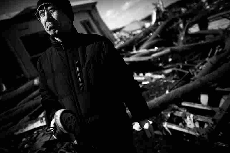 Jun Oshita, 46, holds a single shoe, the only evidence he could find of his mother, Kuni Oshita, 73, who was killed by the March 11 tsunami