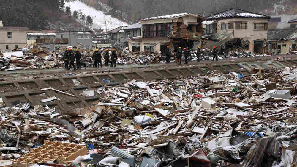 Members of a U.S. search and rescue team from Los Angeles County stand in snow Thursday while on a recovery operation in Kamaishi, Japan. Two search and rescue teams from the U.S. and a team from the U.K., with combined numbers of around 220 personnel, are helping in the aftermath of the earthquake and tsunami.